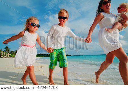 Happy Mother And Kids Enjoy Beach Vacation, Family Have Fun