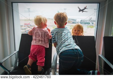 Kids Waiting For Plane In Airport, Family Travel Concept