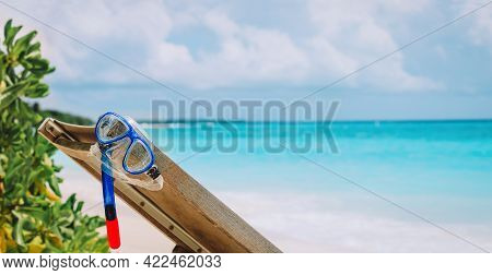 Summer Beach Vacation, Diving Mask And Snorkel On A Wooden Chair At Sea