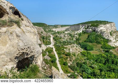 View From Top Of Inkerman Cave Monastery. Classic Crimean White Rocks With Plateau And Caves Of Anci