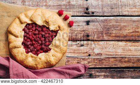 Perfect Raspberry Galette. Delicious Rustic Homemade Tart With Frozen Or Fresh Raspberries On Old Wo