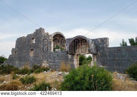 Damaged Walls Of Church In Ancient City Korikos, Kızkalesi, Turkey. Altar Part Of Building Is On Bac