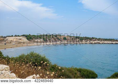 Coastline Of Mediterranean Sea Near Kizkalesi, Turkey. Local People Relaxing On Beach (left Side). R
