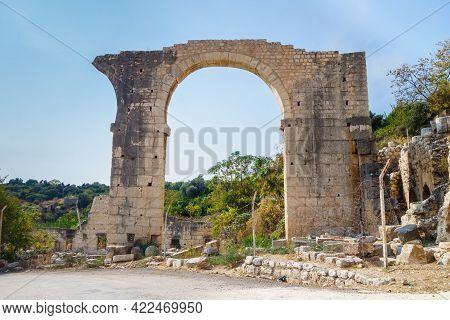 Massive Arch Near Building Of Roman Theater In Ancient City Elaiussa Sebaste, Near Kizkalesi, Turkey