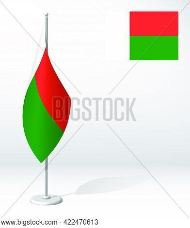 Flag Of Madagascar On Flagpole For Registration Of Solemn Event, Meeting Foreign Guests. National In