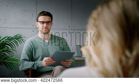 Young patient at the reception of a professional psychotherapist in the office