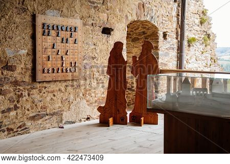 Interiors Of Gothic Medieval Castle Tower, Wooden Figures Of King And Queen, Chess On Masonry Wall,