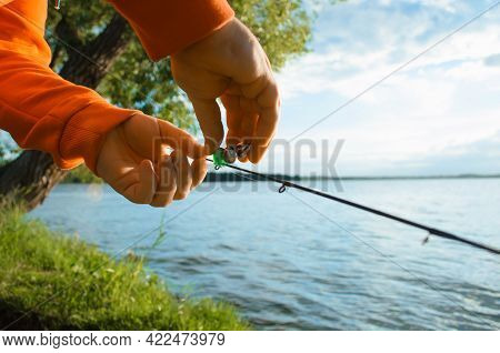 Fishing On The Lake. Fisherman Hanging A Bell On A Fishing Rod, Close-up, Selective Focus. Special E