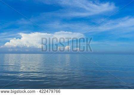 Blue Sky And Sea. Blue Sky And Clouds Over Sea Horizon Background With Smooth Wave Water On The Ocea