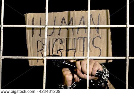 The Concept Of Human Rights Freedom Of Speech Hands Shackled With An Iron Chain Hold A Microphone An