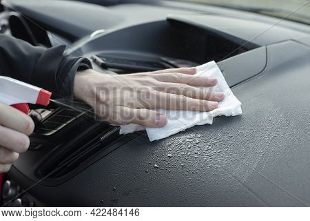 Man Hands Cleaning Dirty Vehicles Interior Uses Wet Rag, Spray Water. Wet Car Cleaning Inside. Sprin