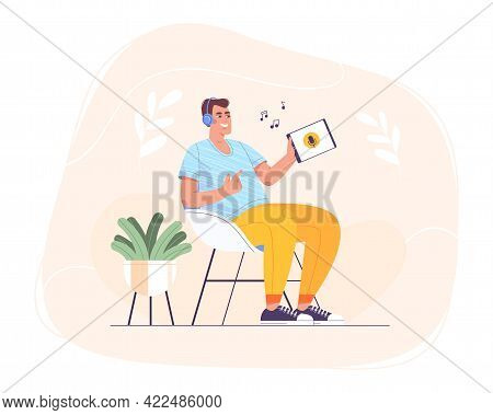 Flat Happy Teen In Headphones Sitting At Home In Chair And Using Tablet For Online Self Education. S