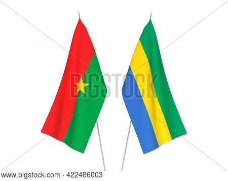 National Fabric Flags Of Gabon And Burkina Faso Isolated On White Background. 3d Rendering Illustrat