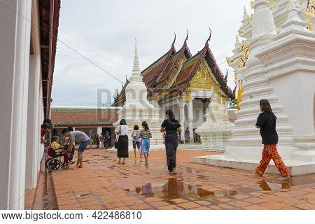 Surat Thani, Thailand - Dec 31,2018 : Thai People Make A Merit Inside Wat Phra Borommathat Chaiya In