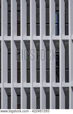 Sunlight On Surface Of Concrete Sunshades Wall Of Modern High Residential Building In Vertical Frame