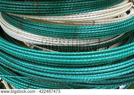 Epoxy Fiberglass Reinforcement For Concrete Reinforcement. The Color Is Green, White. Bundle Close-u
