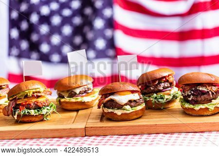 Burgers on american flag. Premium fast food