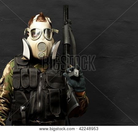 Portrait Of A Soldier With Gas Mask against a grunge background poster