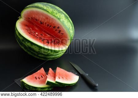 Watermelon, Watermelon Slices And Knife On Black Background