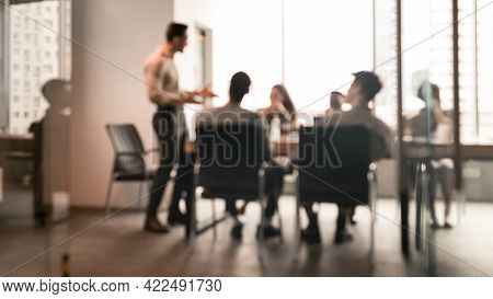 Colleagues Having Meeting In Boardroom, Businessman Giving Speech, Blurred Photo