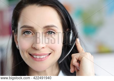 Portrait Of Woman Operator With With Headphones Answering Call