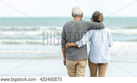 Asian Lifestyle Senior Couple Hug And Stand See Beach Happy In Love Romantic And Relax Time. Touris