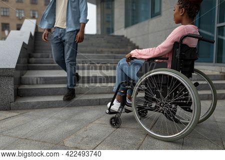 Young Black Disabled Woman Suffering From Lack Of Wheelchair Friendly Facilities, Cannot Get Home Wi