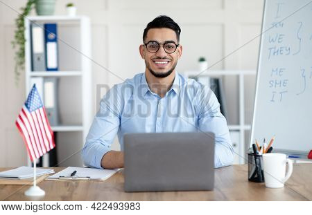 Male Foreign Languages Tutor Teaching English Online Using Laptop At Home Office