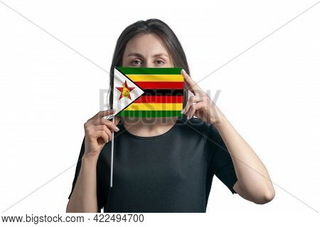 Happy Young White Woman Holding Flag Zimbabwe Flag And Covers Her Face With It Isolated On A White B