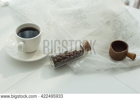 White Coffee Cup And Coffee Beans On White Background.