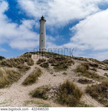 A View Of Sand Dunes On The Jutland Coast Of Denmark With The Lyngvid Fyr Lighthouse