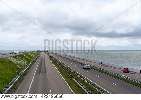 Den Oever, Netherlands - 21 May, 2021: The Highway Leading Across The Dike From Den Oever To Zurich