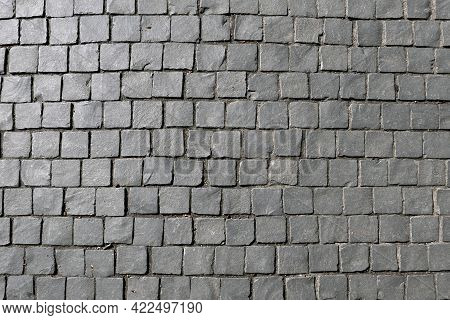 Grey Cobble Stone Background For A Pedestrian Way