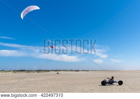 Ringby, Denmark - 30 May, 2021: Kite Buggy Enjoying A Windy Day On The Wadden Sea Island Beaches Of