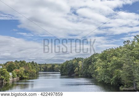 James River At Wilbraham, Usa With Trees And Soft Cloudy Blue Sky