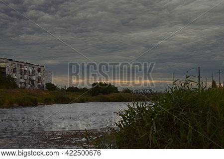 Landscape With A Dark Sky, Overcast Clouds On The Outskirts Of The City.