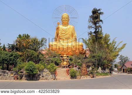 Large Golden Buddha Statue In The City Of Dalat. Vietnam. Dalat Is A City In The Central Highlands O