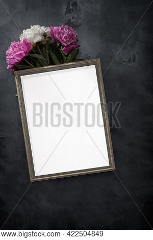 Composition From Flowers. White Photo Frame And Pink And White Pions. Flat Lay, Top View.