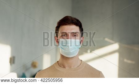 Young man with a blue medical mask