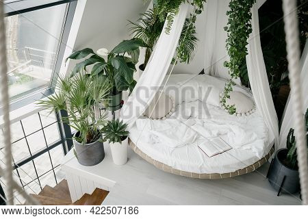 View From Above Of Cozy Light Bedroom In Bohemian Style With Round Canopy Bed On Second House Floor,
