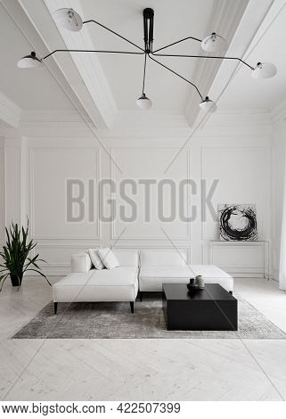 Vertical Shot Of White Leather Sofa On Legs With Cushions On Grey Carpet In Front Of Window In Minim
