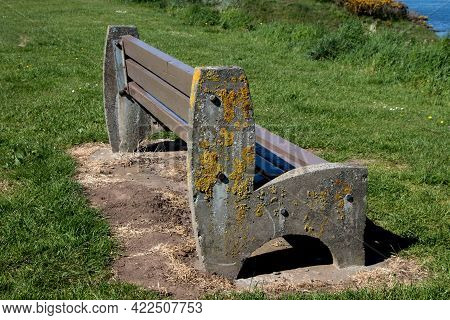 Algae Covered Concrete And Timber Bench At A Coastal Location