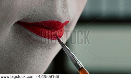 Close Up View Of Beautiful Woman Lips With Red Matt Lipstick.