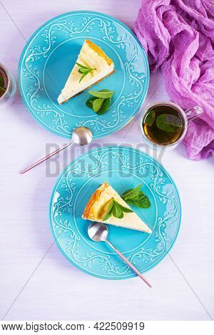 Sliced Cheesecake. Delicious Sweet Cheesecake With Mint Tea On Wooden Background