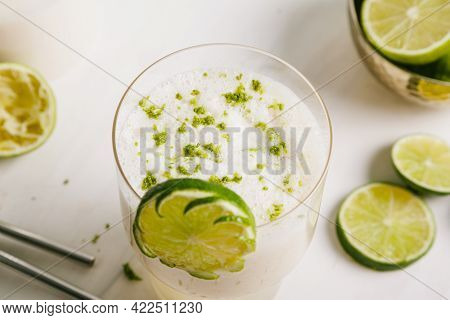 Summer Smoothie. Made With Coconut Milk, Fresh Lime Juice, Lime Zest And Pineapple. Served In A Glas