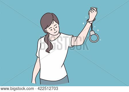 Freedom And Release Concept. Young Positive Girl Cartoon Character Standing And Looking At Handcuffs