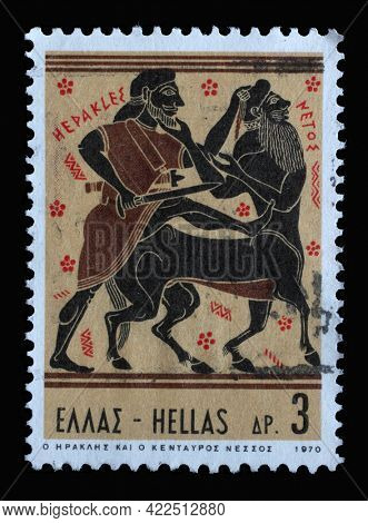 ZAGREB, CROATIA - JUNE 25, 2014: Stamp printed in Greece shows Hercules Deeds - Hercules and Centaur Nessus, circa 1970