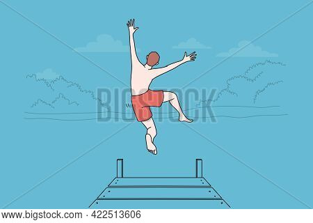Summer Leisure Activities Concept. Young Man Boy Jumping To Water Of Lake Or Sea On Summer Nature La