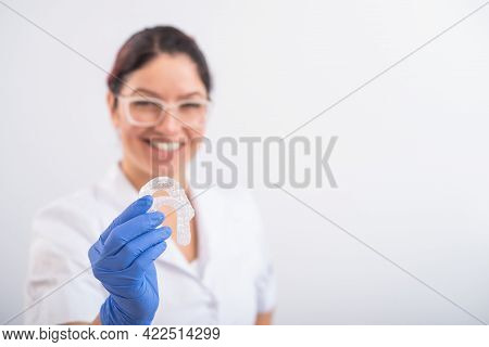 The Orthodontist Holds The Removable Transparent Retainers
