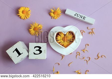 Calendar For June 13: The Name Of The Month Of June In English, Cubes With The Number 13, A Cup Of T